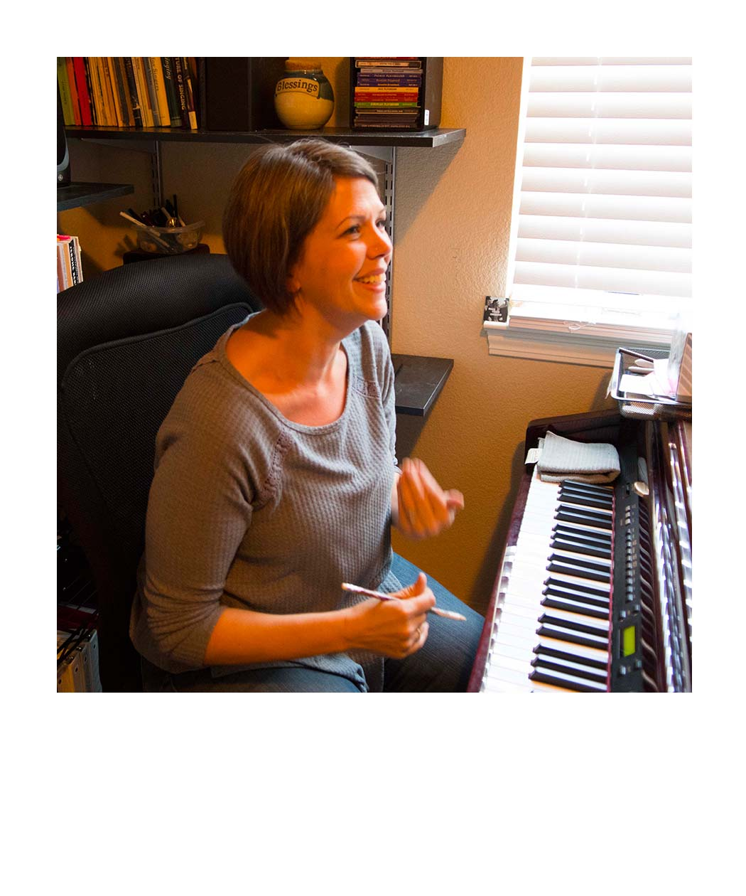 Michelle talking by the piano