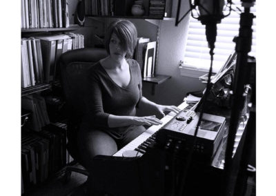 Michelle recording with the mic and piano