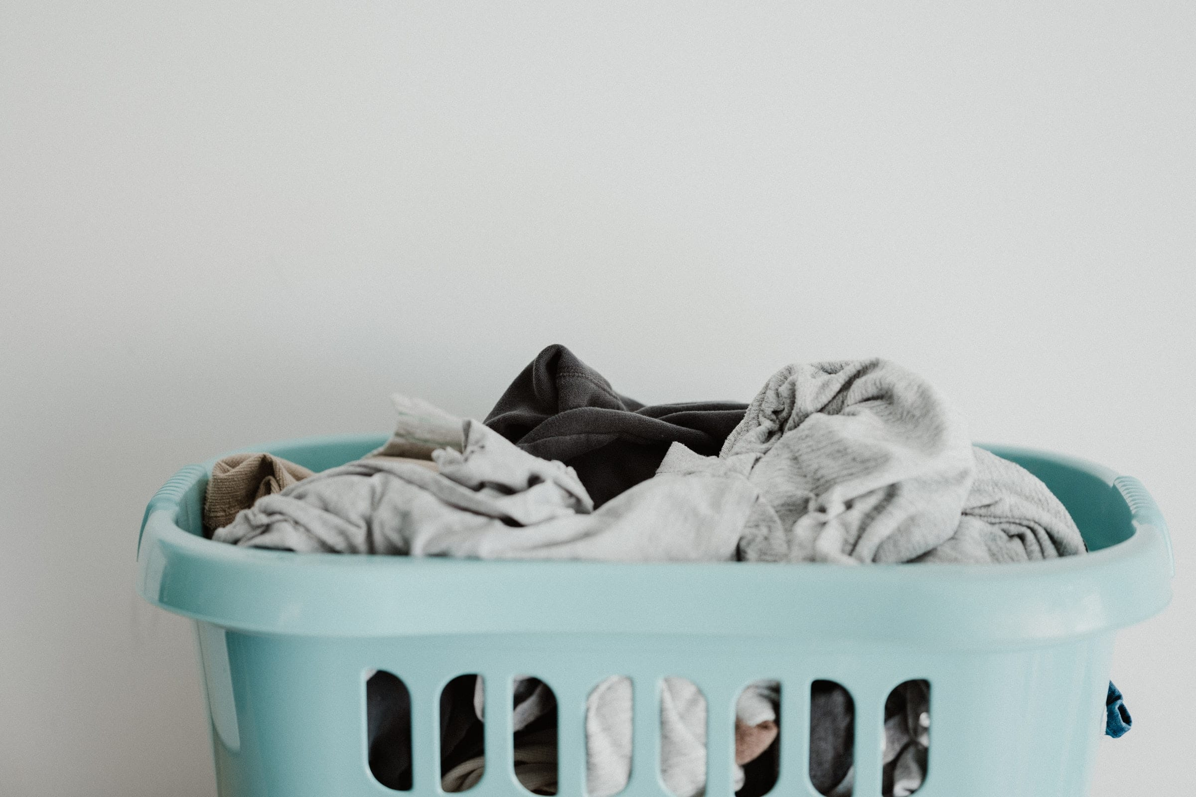 a basket of laundry. Laundry can signify the mundane things we have to do in our lives. We want to make business boring again.